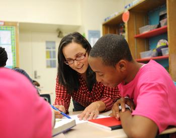 Adelphi alumnae working with high school student